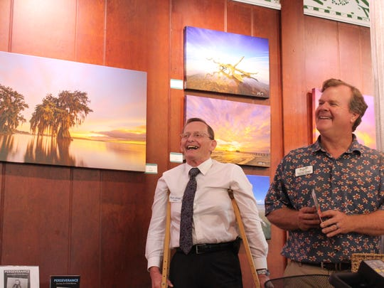 Rich Willett (left) and Thomas Hecker, Everglades Wonder Gardens, during a moment of levity at Willett's book signing on March 16 at the nonprofit.