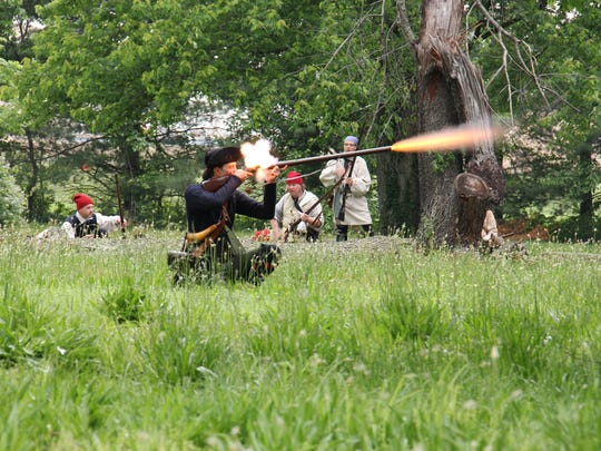 A scout, supported by French militia takes the first shot of the battle during a past Rendezvous in Vincennes.