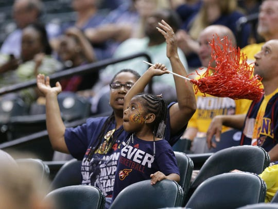 A young fan dances during an Indiana Fever game at