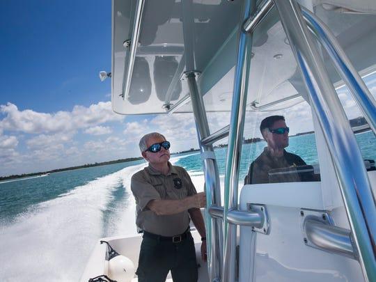 Don Hamilton, 75, left, patrols the Gulf of Mexico alongside Deputy Josh White while volunteering for the CCSO Marine Bureau on Monday, May 22, 2017.