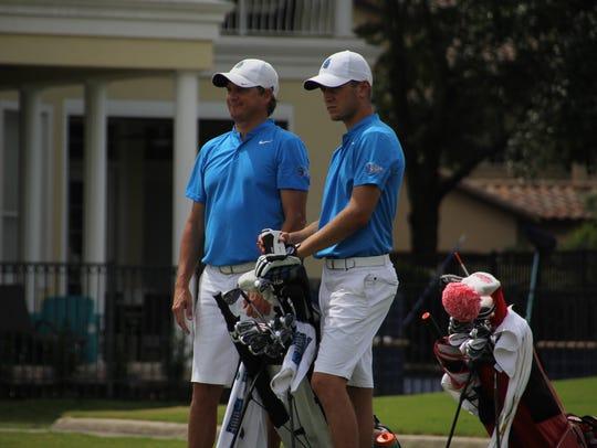 UWF men's golf coach Steve Fell (left), shown with