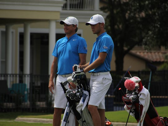 UWF men's golf coach Steve Fell (left), shown with