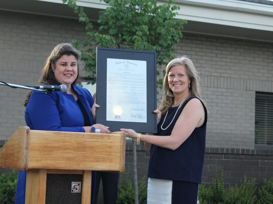 State Rep. Dawn White hands over a proclamation to Alive Hospice President and CEO Anna-Gene O'Neal
