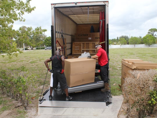 Unloading takes place outside the Y's workout gym.