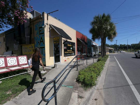 Businesses on the intersection of Railroad Avenue and All Saints Street, including Bread and Roses Food Co-Op, the location for proposed development.