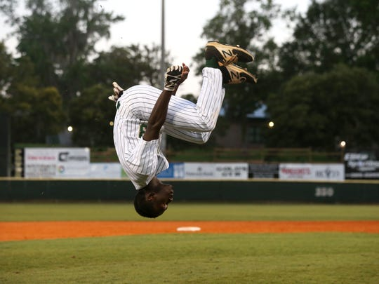 Lincoln's pulls a back flip in celebration of the Trojans 2-0 Region 1-8A final win over Wharton at Lincoln High School on Friday, May 26, 2017.