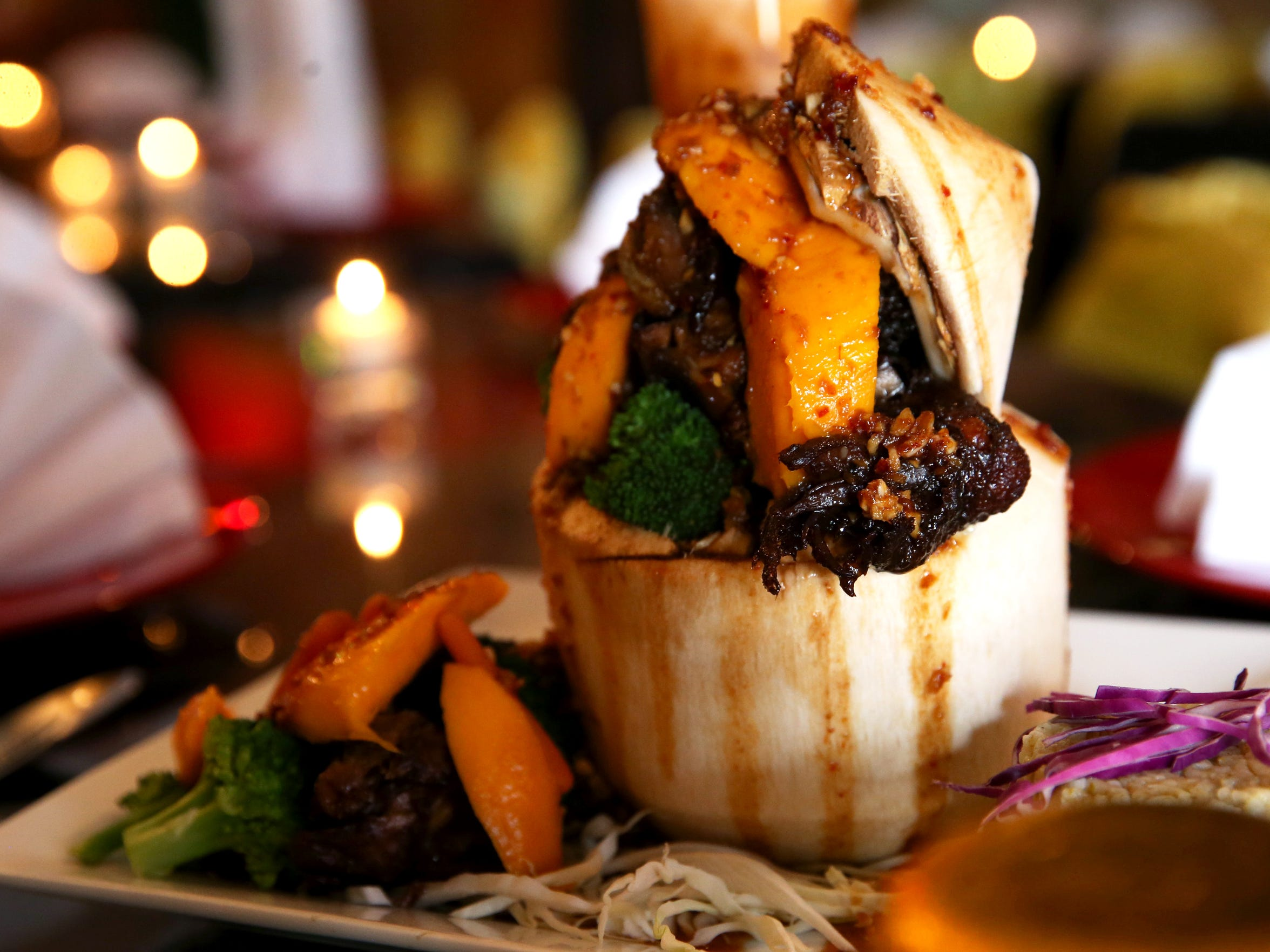 A mango duck with black bean sauce, sliced and pureed mango, served inside of a coconut and prepared by Nipada Mulsing, or Chef Donna as she is known to her customers, at Reangthai Restaurant.