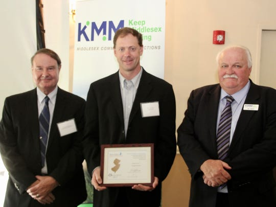 KMM Chairman Ron Hutchinson, John Riesner of Magyar Bank and KMM Executive Director Bill Neary were among those at KMM's Annual Membership Meeting.