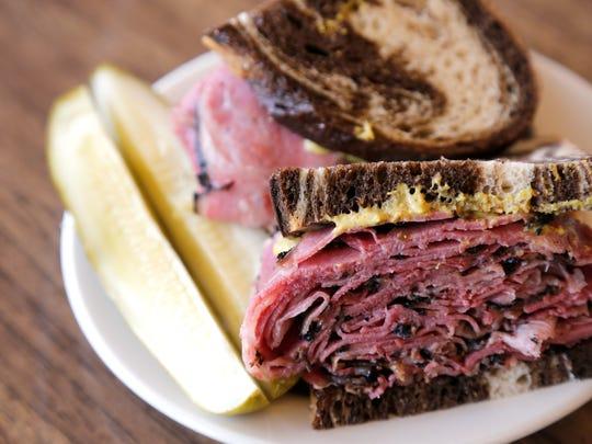 A pastrami sandwich is posed at Shapiro's Delicatessen