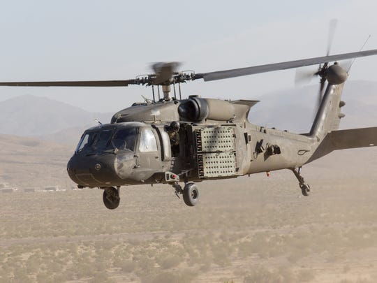 A Black Hawk is equipped with the Volcano mine system