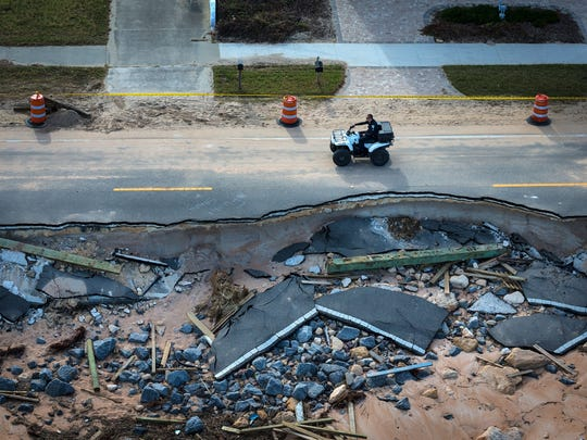 In this October 2016 file photo, a section of State Road A1A sits badly damaged by erosion after Hurricane Matthew passed the east coast of Florida. The section of road had been previously undermined and recently Flagler County officials had began a beach renourishment process.