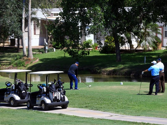 Golfers play a game at the River Bend Resort & Golf