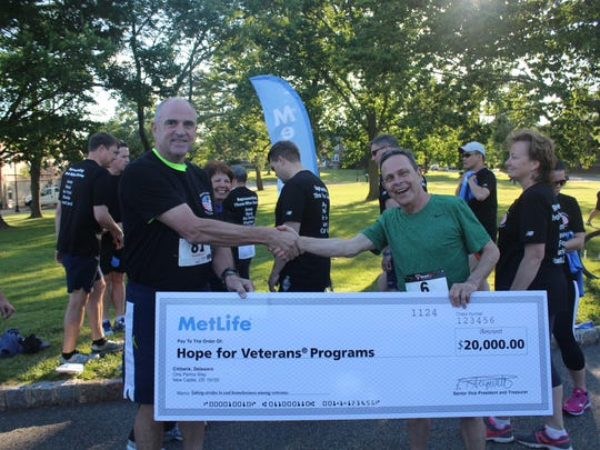 Two runners revel in the philanthropic side of the 2016 Flag Day 5K Run and Fun Walk.