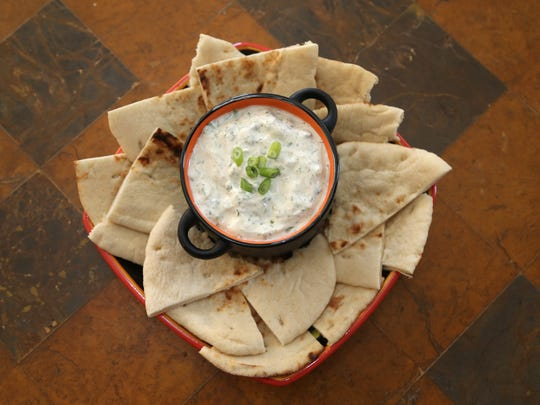 Indian Raita with naan made by Robin Miller at her home in Scottsdale. on May 18, 2017.