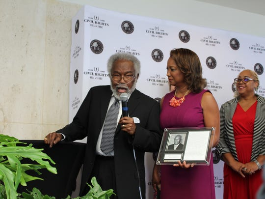 Florida Civil Rights Hall of Fame inductee Willie H. Williams delivers a speech during Wednesday's ceremony as former Lt. Gov. Jennifer Carroll looks on.