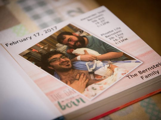 Jeffrey Bernstein, left, and husband Brian created a book of letters for each day their son and daughter were in the neonatal intensive care unit after being born prematurely.