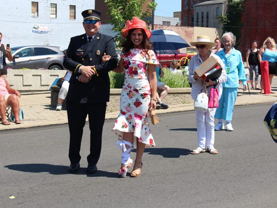 Miss Ohio contestant Madeline Carter is escorted to the  Richland Carrousel Park after the Miss Ohio Parade on Sunday. Carter, a Mansfield native, is competing as Miss Greater Cleveland.