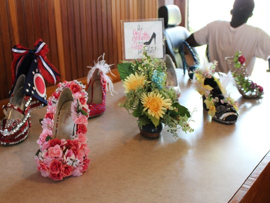 Some of the contestants' shoes are displayed at the Richland Carrousel Park after the Miss Ohio Parade on Sunday, June 11, 2017. This year's parade included 19 Miss Ohio contestants and 15 Miss Ohio Outstanding Teen contestants.