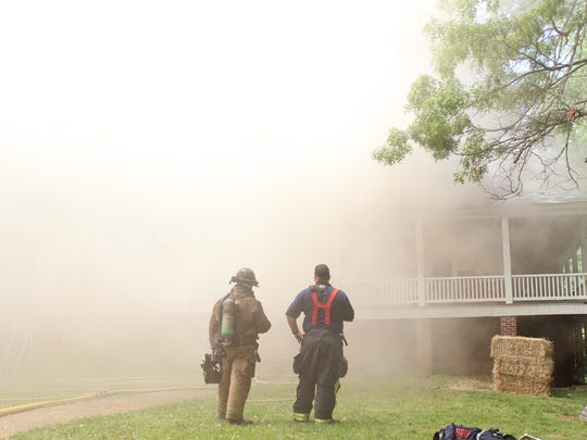 Nathan Waldrup (at right), who served as the incident commander throughout the training, assess the situation with a trainer from the Asheville Fire Department.