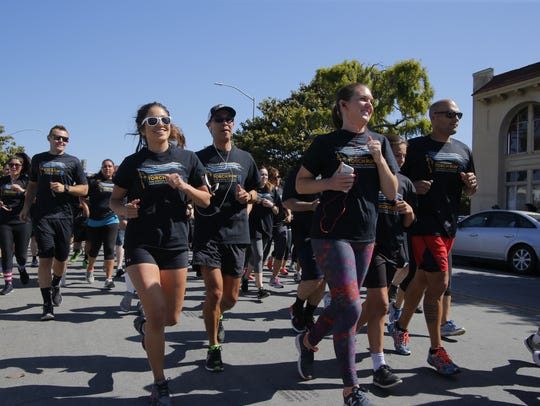 Runners begin the Torch Run on Tuesday.