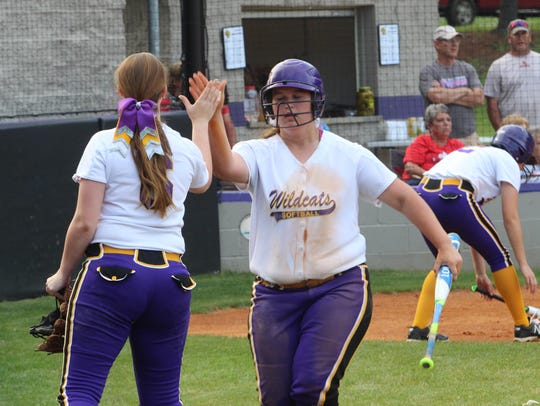Clarksville High's Peyton Wilson is congratulated by