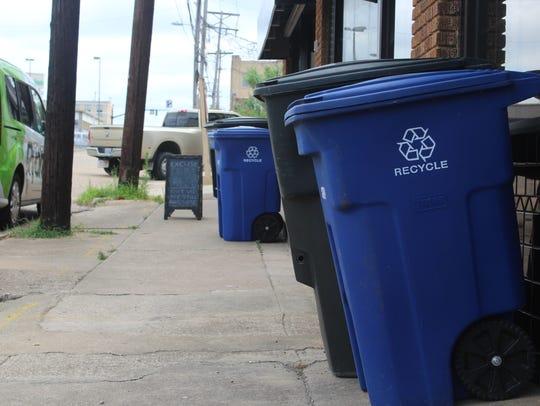 Recycling carts along Lake Street.