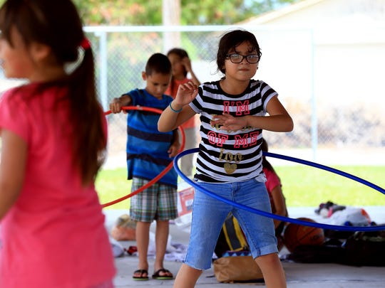 Analia Melena plays with a hula hoop during the West Side Helping Hand Summer Program on Friday, June 16, 2017, in Corpus Christi.