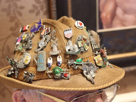 """Charlie Hyke wore his hat covered in pins to the """"Men of The Terraces"""" expo, where he shared stories of his pewter collection from Germany."""