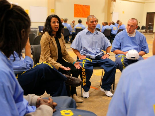 Michelle Martinez, 24, talks with inmates about how