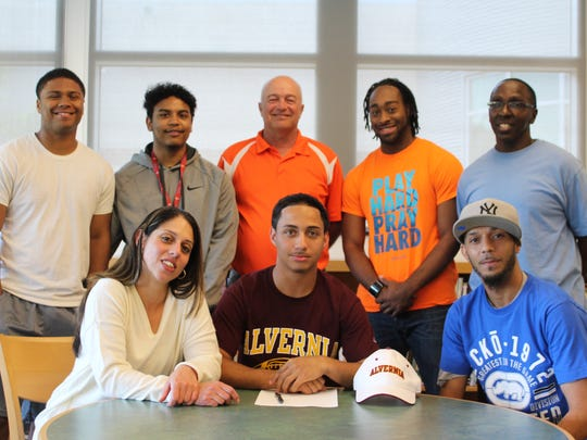 Central York High School senior athlete Jordan Bowie recently signed a National Letter of Intent to play football for Alvernia University. Bowie plans to major in sports management. Bowie (seated, center) is flanked by mother, Jennifer Ortiz, and his father, Tim Bowie. In the back, from left, are Bowie's brothers, Shannon Valenti and Josiah Orr, Marty Trimmer (Central York athletic director), and LaQuinn Tompson and Chris Day, his mentors.