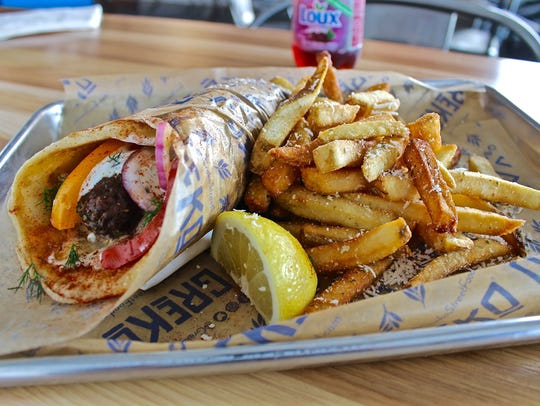 Pork souvlaki pita, served with Greko Street Fries