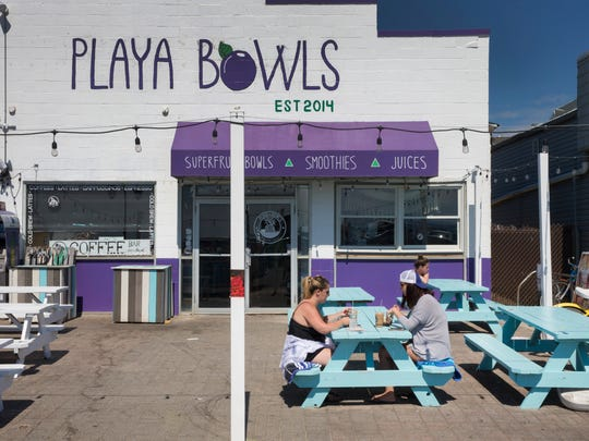 Abby Taylor and Robert Guiliani came up with an idea to start a business selling acai berries and other health food at the Jersey Shore. It turned into Playa Bowls, and they are expanding fast.