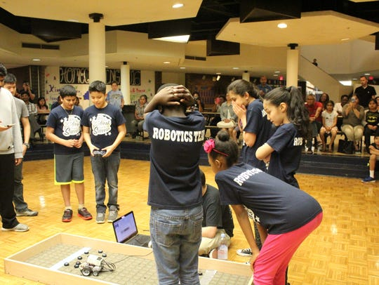 Fourth- and fifth-grade students competed in a robotics