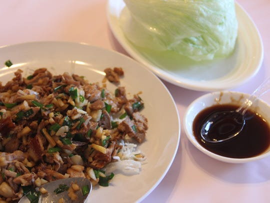 Happy Dragon followed its semi-traditional Peking duck service with a lettuce wrap, using the leftover duck from the serving.