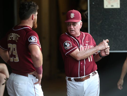 FSU Head Coach Mike MArtin works with Quincy Nieporte