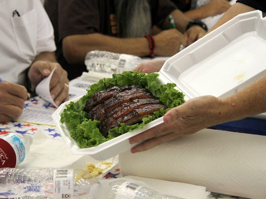 A judge presents ribs to judges to be evaluated on
