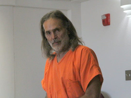Neil D. Ochoa enters a 12th Judicial District courtroom for his sentencing hearing before Judge Angie K. Schneider June 21. Ochoa was sentenced to 21 years in prison for trafficking narcotics.