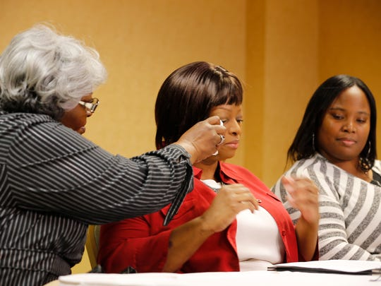 Audrey DuBose, Sam DuBose's mother, dabs away tears