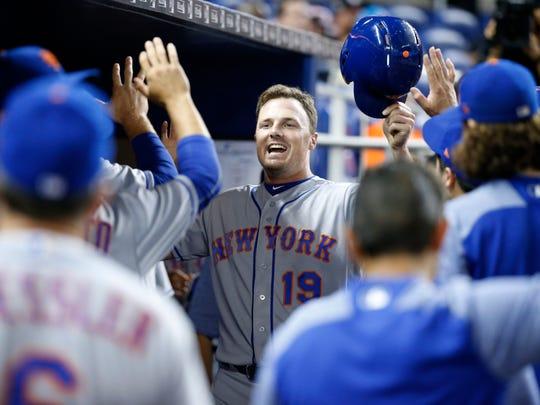 New York Mets' Jay Bruce celebrates after scoring on