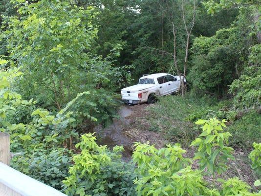 Lexington truck in creek