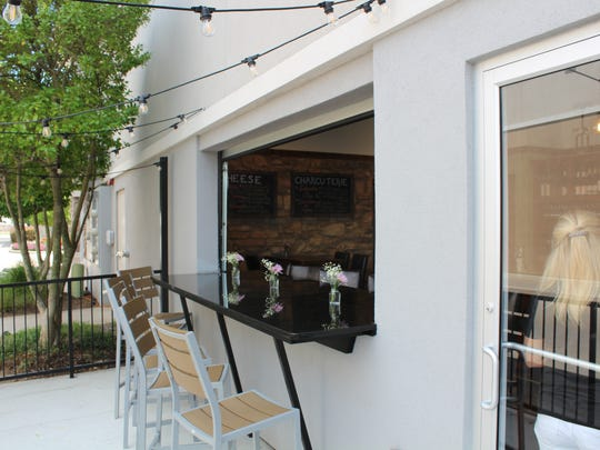 Outdoor seating at We Olive in Shreveport