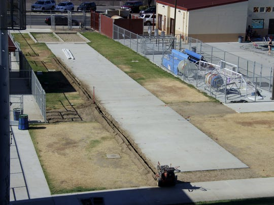 The new long jump and triple jump runway and sand pit under construction at Tulare's Bob Mathias Stadium on Wednesday, June 28, 2017.