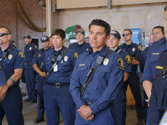 Members of the hazardous-materials response team listen as Salinas Fire Chief Ed Rodriguez talks about the newly acquired haz-mat response vehicle during a special dedication ceremony Thursday.