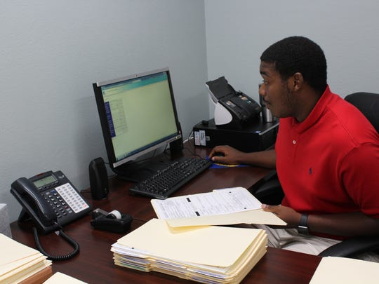 Tyler Thomas, a college student at Louisiana Tech, works as an administrative assistant for Caddo Parish through the summer youth work program.