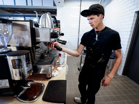 Edge Alley, head barista Tyler Cruze gets a cappuccino