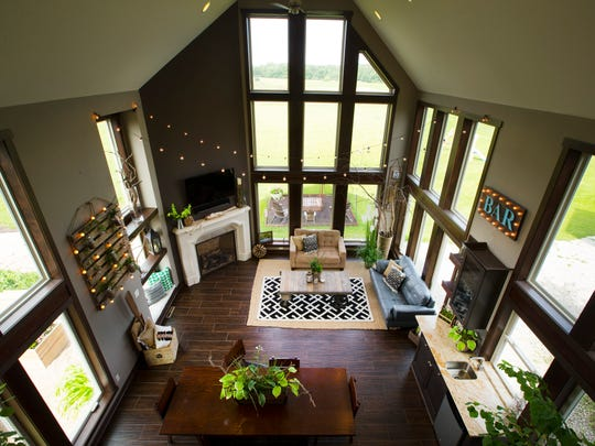 The 18-by-12-foot sun room was designed to give the home a barn-like look.