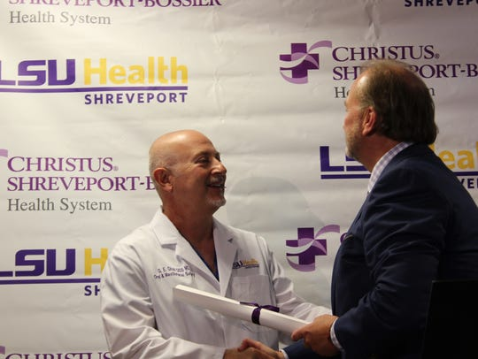 Christus Senior Vice President Stephen Wright congratulates