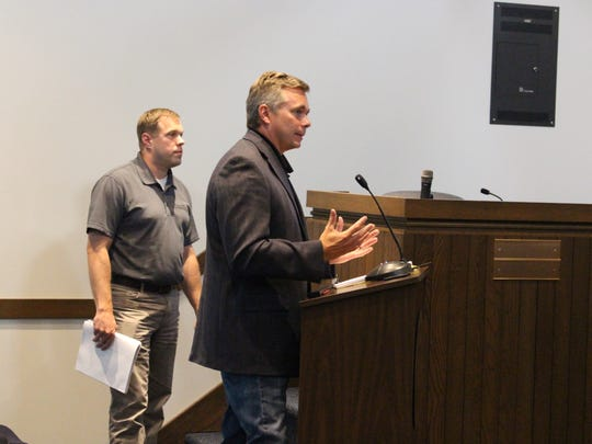 Canton-based developer Grant Giltz presents to the Ontario city planning commission about a new six-store retail complex Wednesday, July 12, 2017. Project engineer Mark Rufener with K.E. McCartney and Associates Inc. stands to the left.