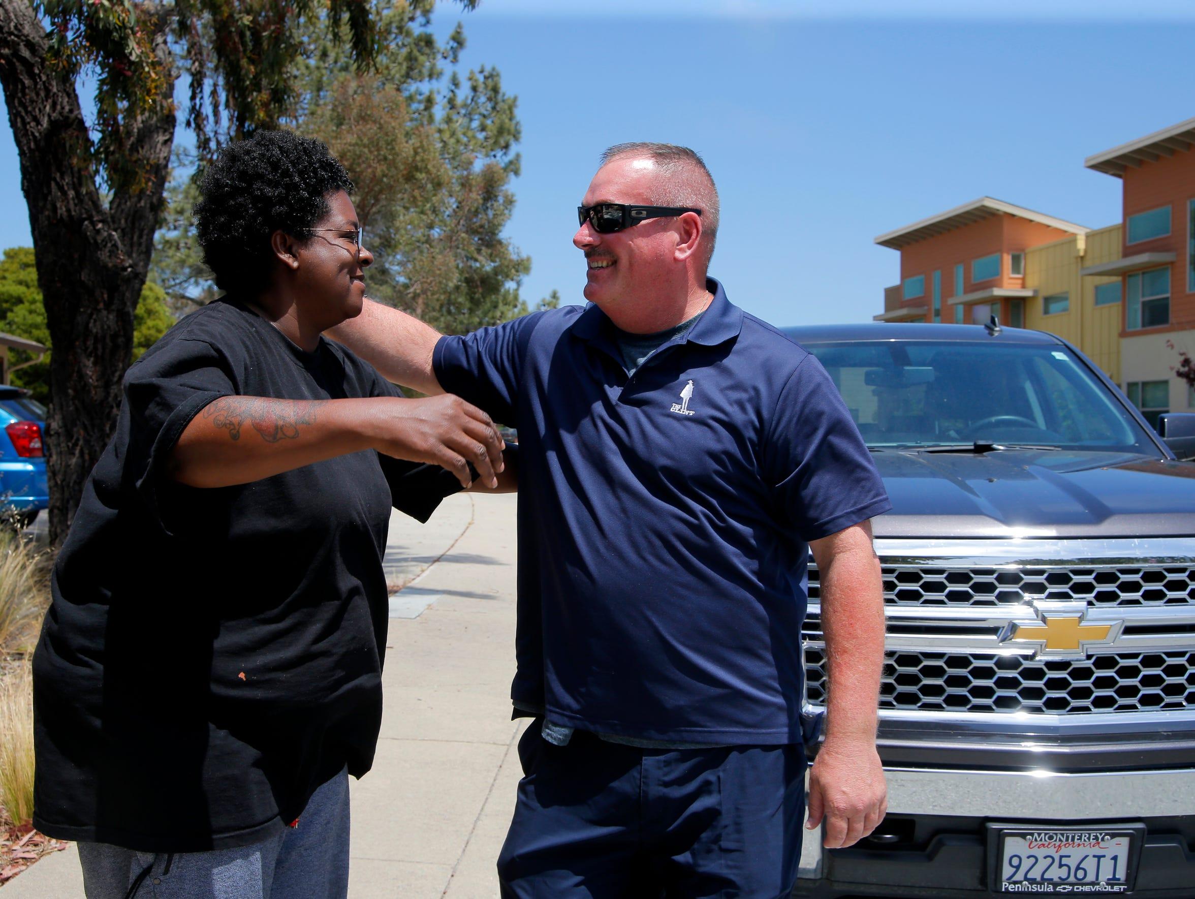 Yolanda Harraway embraces Salinas Police Cmdr. Dave