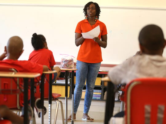 Jenelle Robinson, a professor from FAMU's Food Science department, leads kindergarten through second grade students on a nutrition lesson plan at FAMU DRS High School Wednesday for a six-week course created by the North Florida Freedom Schools.